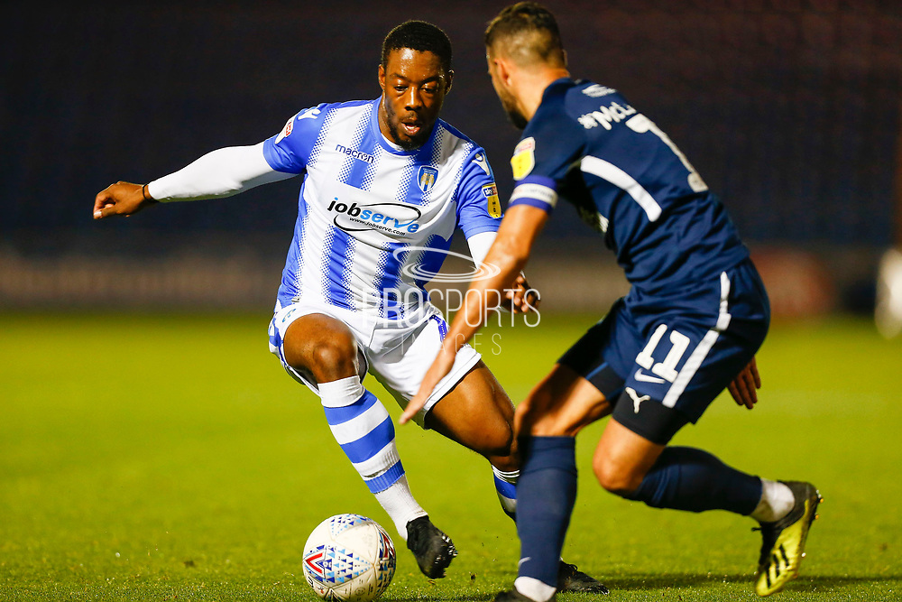 Colchester United defender Ryan Jackson (2) Southend United midfielder Stephen McLaughlin during the EFL Trophy match between Colchester United and Southend United at the Weston Homes Community Stadium, Colchester, England on 9 October 2018.