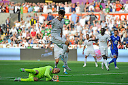 Ki Sung-Yueng of Swansea City is denied by Everton goalkeeper Tim Howard late in the second half.<br /> Barclays Premier League match, Swansea city v Everton at the Liberty Stadium in Swansea, South Wales on Saturday 19th September 2015.<br /> pic by Phil Rees, Andrew Orchard sports photography.