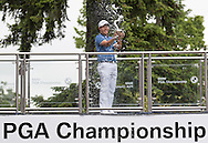 Byeong Hun AN celebrates with the trophy and champagne during the 4th day of the BMW PGA Championship at Wentworth, Virginia Water, United Kingdom on 24 May 2015. Photo by Ellie  Hoad.