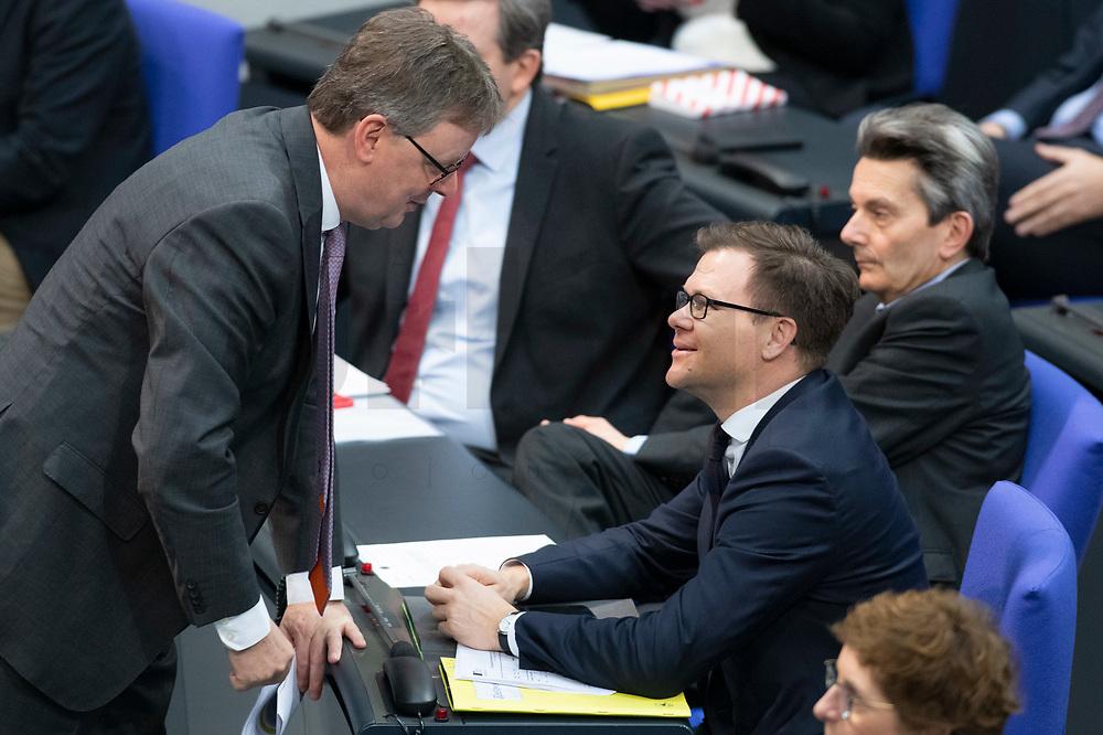 13 FEB 2020, BERLIN/GERMANY:<br /> Michael Grosse-Brömer (L), CDU, 1. Parl. Geschaeftsfuehrer der CDU/CSU Bundestagsfraktion, und Carsten Schneider (R), SPD, 1. Parl. Geschaeftsfuehrer der SPD bundestagsfraktion, Sitzung des Deutsche Bundestages, Plenum, Reichstagsgebaeude<br /> IMAGE: 20200213-01-015<br /> KEYWORDS: Michael Grosse-Brömer, Gespräch