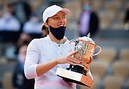 Iga Swiatek of Poland with the champions trophy after winning against Sofia Kenin of the United States the final of the Roland Garros 2020, Grand Slam tennis tournament, on October 10, 2020 at Roland Garros stadium in Paris, France - Photo Rob Prange / Spain ProSportsImages / DPPI / ProSportsImages / DPPI