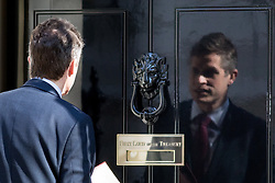 © Licensed to London News Pictures. 01/05/2018. London, UK. Defence Secretary Gavin Williamson seen reflected in the door of No 10, as he arrives in Downing Street to attend a Cabinet meeting this morning. Cabinet positions have recently shuffled around, following Amber Rudd's resignation as Home Secretary, following the Windrush scandal. Photo credit : Tom Nicholson/LNP