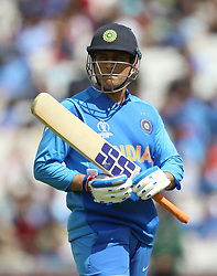 India's MS Dhoni walks off after losing his wicket during the ICC Cricket World Cup Warm up match at The Oval, London.