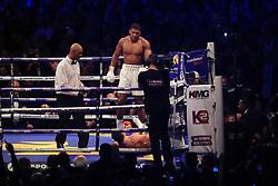 29 April 2017 - Boxing - Anthony Joshua v Wladimir Klitschko (IBF and WBA heavyweight) - Joshua stands over Klitschko after knocking him out - Photo: Marc Atkins / Offside.