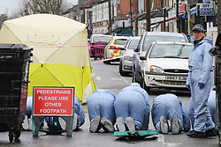 © Licensed to London News Pictures. 09/04/2019. London, UK. Crime scene investigators carries out the search on Church Road, Manor Park, East London where a man in his 20s was shot and stabbed to death on Monday 8 April 2019. Police were called around 9.30pm and the man was was found with knife and gunshot wounds. The victim was pronounced dead at the scene. <br />  Photo credit: Dinendra Haria/LNP