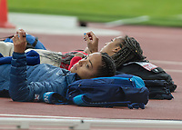 Athletics - 2017 IAAF London World Athletics Championships - Day Two (AM Session)<br /> <br /> Event: High Jump Women - Heptathlon<br /> <br /> Katarina Johnson-Thompson (GBR) and Nafissatou Thiam (BEL) relax before they take their jumps<br /> <br /> COLORSPORT/DANIEL BEARHAM