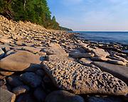 Rocky limestone shore of Georgian Bay at Cape Dundas, Lake Huron, Bruce Peninsula, Ontario, Canada.