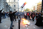 Burning placards. National student demonstration in London, protesting against tuition fees and the threat of top-up fees. Students from all over the UK gathered in central London for a second mass demo in protest of the coalition govenrnment's plans for education funding. Centred around Whitehall the protest was partly peaceful but also marred by arrests and some violence.