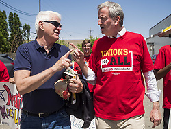 May 23, 2019, Urbandale, Iowa, U.S.: BILL DE BLASIO, mayor of New York City, right, talks to a union activist after a picket of a McDonald's in Urbandale, a Des Moines suburb. De Blasio called on the fast food chain to raise its minimum wage to $15.00 per hour and improve worker safety. He joined the field of Democrats vying to be the party's candidate in the 2020 presidential election last week. Iowa traditionally hosts the the first election event of the presidential election cycle. The Iowa Caucuses will be on Feb. 3, 2020. (Credit Image: © Jack Kurtz/ZUMA Wire)