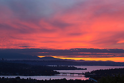 North America, United States, Washington, Seattle, downtown skyline and Lake Washington with I-90 bridge, with Olympic Mountains in distance