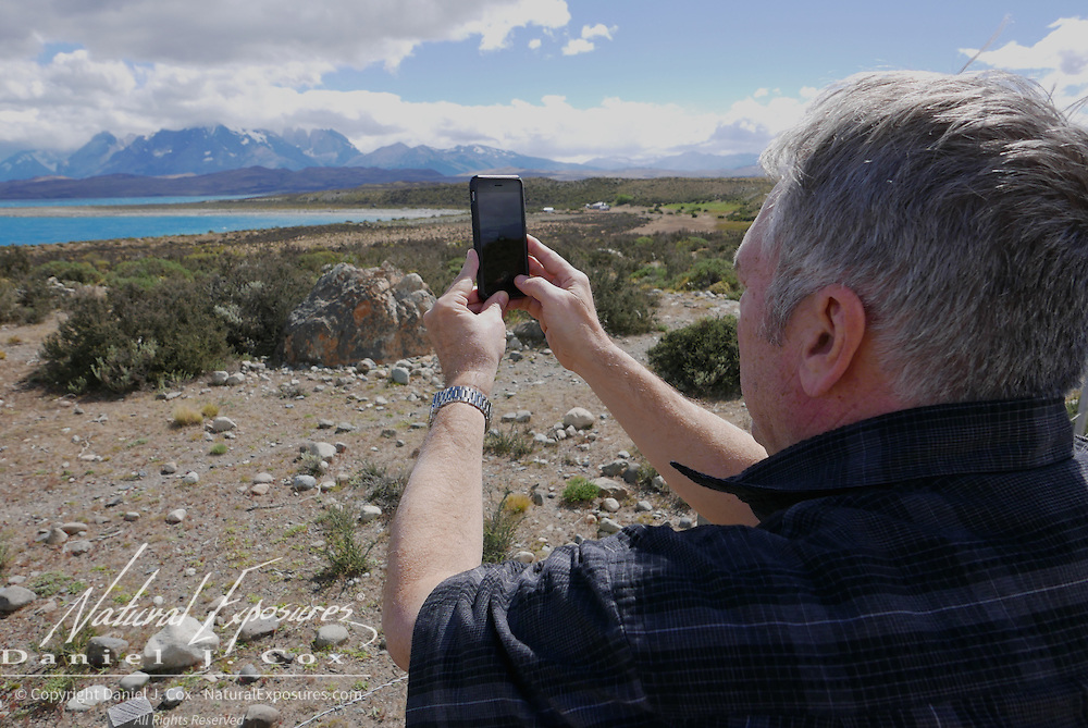 Freddy takes an iphone shot  along the road in Torres del Paine National Park. Patagonia, Argentina
