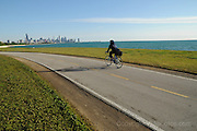 Thursday, June 4, 2009- Kenya Butts heads north on Chicago's lakefront path near Oakwood Blvd. on her way to work on the city's northwest side, about a 14 mile trip from her Jackson Park Highlands home that she makes several times every week.
