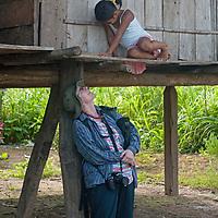 A hiker encounters a Yanayacu Indian girl in Ayacucho de Tipisha village in Peru's Amazon Jungle.