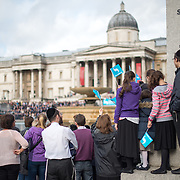 Crowds watch a parade of the Sea Cadets in Trafalgar Square in central London. The British National Gallery is in the background.