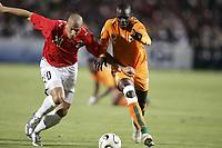 Fotball<br /> Foto: Dppi/Digitalsport<br /> NORWAY ONLY<br /> <br /> FOOTBALL - AFRICAN CUP OF NATIONS 2006 - FINAL - 060210 - EGYPT v IVORY COAST / ELFENBENSKYSTEN - WAEL GOMAA (EGY) / KANGA AKALE (CIV)