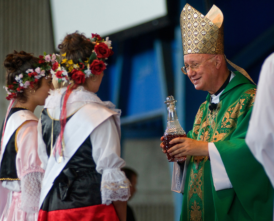 Archbishop Caludio Maria Celli receives the gifts from the Festa Regional and Renaissance Dancers during mass at Festa Italiana, Sunday, July 18.
