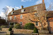 Manor Farmhouse, C 18th century red brick farmhouse building, Avebury village, Wiltshire, England, UK