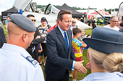 © Licensed to London News Pictures. 21/07/2014. Llanelwedd, UK. David Cameron visits the military stand at the show. A record numbers of visitors in excess of 240,000 are expected this week over the four day period of Europeís largest agricultural show. Livestock classes and special awards have attracted 8,000 plus entries, 670 more than last year. The first ever Royal Welsh Show was at Aberystwyth in 1904 and attracted 442 livestock entries. Photo credit: Graham M. Lawrence/LNP