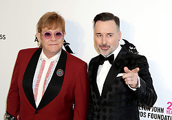 Elton John (left) and David Furnish arriving at the Elton John Oscar Party held in Beverly Hills, Los Angeles, USA.