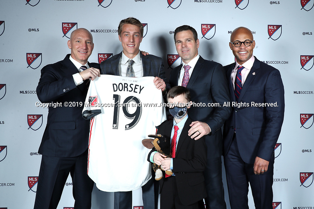 CHICAGO, IL - JANUARY 11: Griffin Dorsey was taken with the sixth overall pick by Toronto FC. With team president Bill Manning (left), head coach Greg Vanney (second from right), general manager Ali Curtis (right), and Caleb Anderson (below). The MLS SuperDraft 2019 presented by adidas was held on January 11, 2019 at McCormick Place in Chicago, IL.
