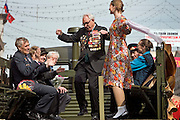 Moscow, Russia, 08/05/2005..Russia celebrates the 60th anniversary of the end Second World War, generally referred to in Russia as the Great Patriotic War. A miltary veteran dances to wartime music on a truck during a parade in central Moscow..