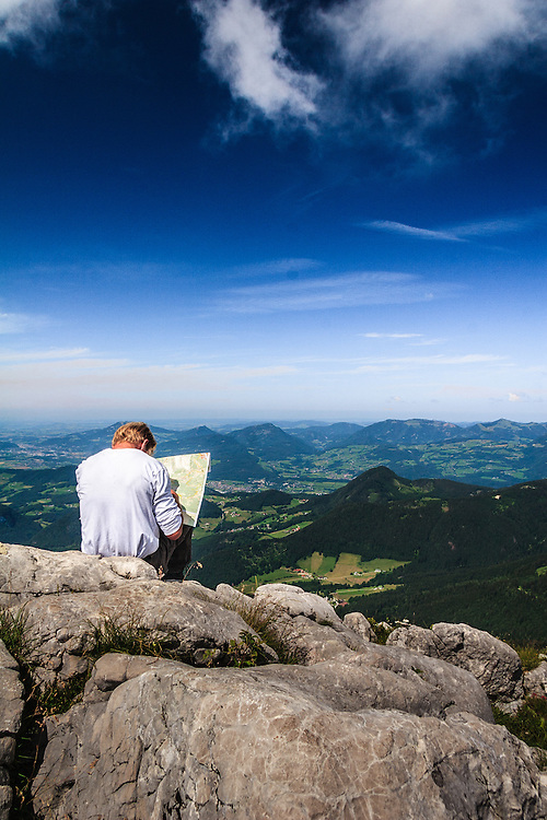 A hiker studies his map on Kehlstein in Obersalzberg, Germany. Hiking in the Bavarian Alps is a national pastime in Bavaria.