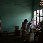 Members of the Burundian National Independent Electoral Commission count votes for the parliamentary elections at a polling station in Bwiza neighbourhood, Bujumbura, June 29, 2015.