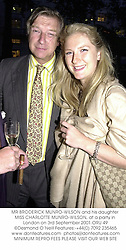 MR BRODERICK MUNRO-WILSON and his daughter MISS CHARLOTTE MUNRO-WILSON, at a party in London on 3rd September 2001.ORU 49