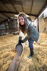 Anna out at Kate Roswell's farm at Hundleshope. Story on the farm in Peebleshire about the current state of women in farming. Feeding the sheep.