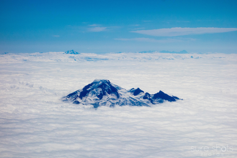 Rocky Mountains from the air, above the clouds