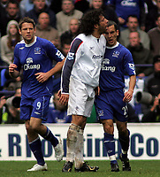 Photo: Paul Thomas.<br /> Bolton Wanderers v Everton. The Barclays Premiership. 09/04/2007.<br /> <br /> Ivan Campo (White) of Bolton pushes out at Leon Osman (R) after Campo accuses Osman of diving.