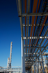 Stock photo of an elevated outdoor walkway at a chemical plant