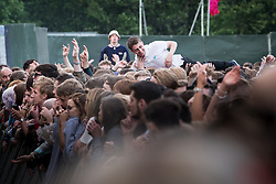 © Licensed to London News Pictures . 05/06/2015 . Manchester , UK . Man crowdsurfing . Evening concerts featuring headliners , The Courteeners , playing a homecoming gig , at Heaton Park in Manchester in front of 25,000 people , the evening before the Parklife music festival . Photo credit : Joel Goodman/LNP