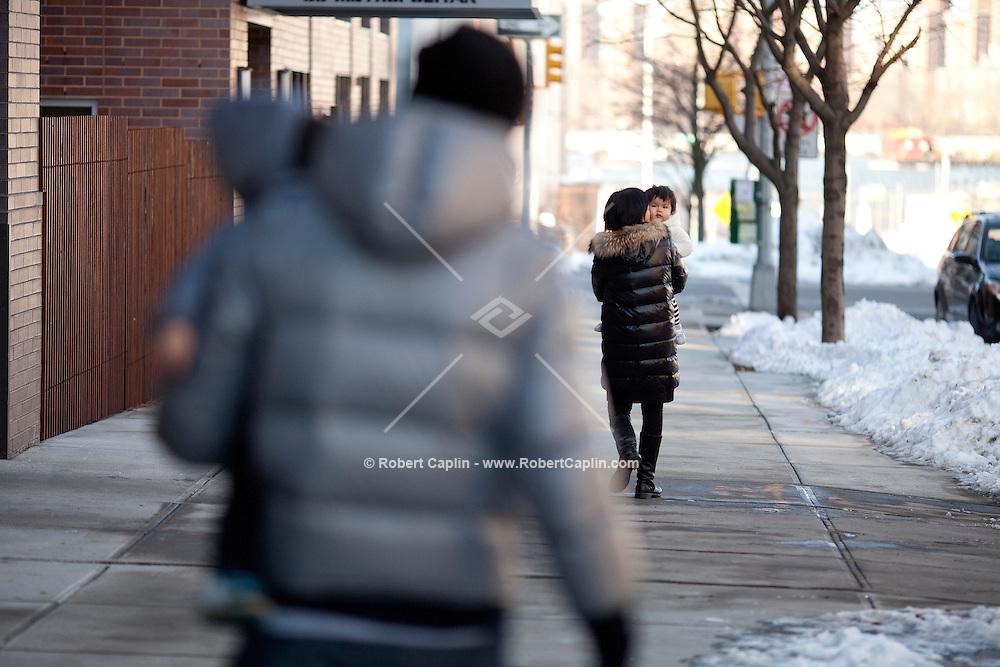 Alex Signer, Ayumi Konishi and their twins Miu and Teo live at 80 Metropolitan Ave in Williamsburg, Brooklyn...Photo copyright Robert Caplin