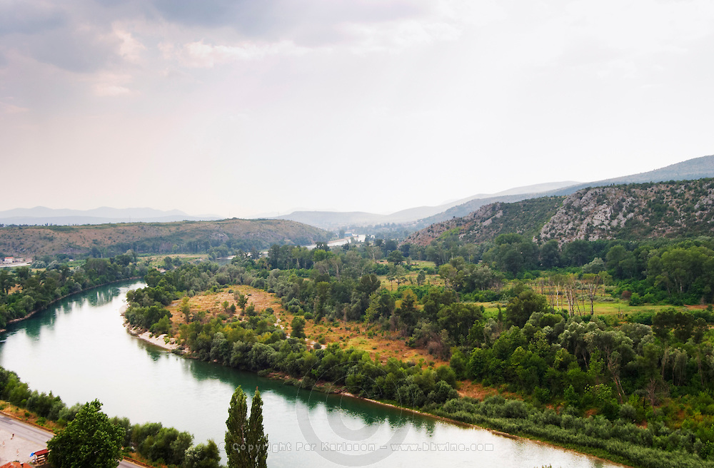 View from the hilltop tower over the Neretva river and the plain in the river valley. Towards the Croatian coast. Pocitelj historic Muslim and Christian village near Mostar. Federation Bosne i Hercegovine. Bosnia Herzegovina, Europe.