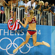 Kerri Walsh, center, celebrated with the friends and family in the grandstands after winning the gold medal in women's beach volleyball at the Beach Volleyball Centre in Athens, Greece in the 2004 Summer Olympic Games. Walsh and teammate Misty May defeated the team from Brazil.