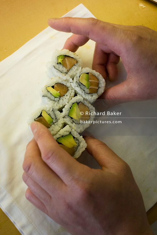 Detail of a chef's hands, preparing Makizushi in 'So', a sushi restaurant in central London.