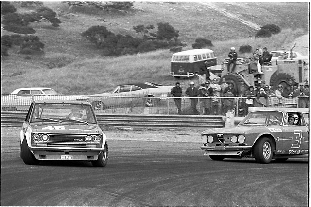 Second image in sequence showing Horst Kwech (no. 3 Alfa Romeo) punting John Morton (no. 48 Datsun) in the hairpin turn at Laguna Seca during the 1971 under-2-liter Trans-Am race