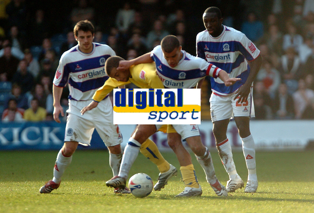 Photo: Tony Oudot.<br />Queens Park Rangers v Sheffield Wednesday. Coca Cola Championship. 10/03/2007.<br />Marcus Bignot of QPR goes past Deon Burton of Sheffield Wednesday
