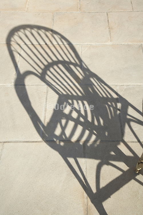 shadow of a outdoors wicker chair