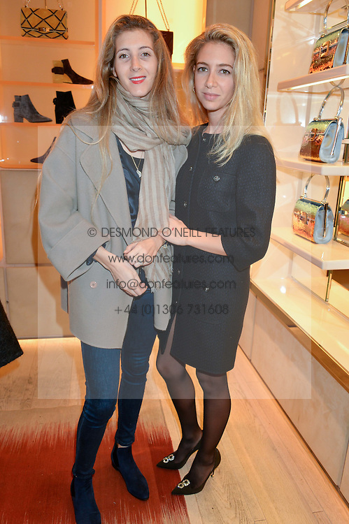 Left to right, DAPHNE SCHMITZ-CRAMER and SABINE GHANEM at the Roger Vivier 'The Perfect Pair' Frieze cocktail party celebrating Ambra Medda & 'Miss Viv' at the Roger Vivier Boutique, Sloane Street, London on 15th October 2014.