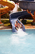 Father and son of 5 on a water slide
