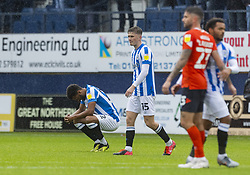 Huddersfield Town's Fraizer Campbell (left) and Scott High (centre) look dejected after the Sky Bet Championship match at Kenilworth Road, Luton. Picture date: Saturday October 2, 2021.