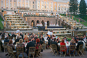 Saint Petersburg, Russia, June 2002..The Kirov Ballet performs at 11pm in Peterhof Palace gardens on the Gulf of Finland at the Stars of the White Nights midsummer ball. The mid-summer White Nights period when the sun sets only briefly is a time of festivals, entertainment and walks along the Neva River to watch the city bridges raise for shipping..