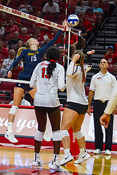 BLOOMINGTON, IL - September 15: Ellie Koontz tries reaching the ball behind the out of bounds marker during a college Women's volleyball match between the ISU Redbirds and the Marquette Golden Eagles on September 15 2019 at Illinois State University in Normal, IL. (Photo by Alan Look)