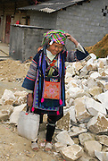 Vietnam, Sapa Market, Black Hmong woman in traditional dress