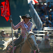 The Darby Rodeo Queen presents the Red Eye Rodeo colors at the Darby MT Elite Proffesionals Bull Riding Event July 7th 2017.  Photo by Josh Homer/Burning Ember Photography.  Photo credit must be given on all uses.