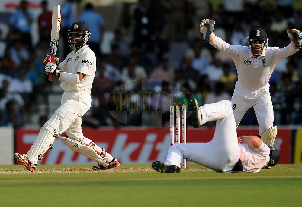 Cheteshwar Pujara of India looks on as he is been caught out by Ian Bell of England during day two of the 4th Airtel Test Match between India and England held at VCA ground in Nagpur on the 14th December 2012..Photo by  Pal Pillai/BCCI/SPORTZPICS .