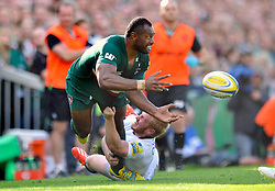 Leicester Tigers winger Vereniki Goneva offloads the ball after being tackled by Newcastle Falcons winger Tom Catterick - Photo mandatory by-line: Patrick Khachfe/JMP - Tel: Mobile: 07966 386802 - 21/09/2013 - SPORT - RUGBY UNION - Welford Road Stadium - Leicester Tigers v Newcastle Falcons - Aviva Premiership.