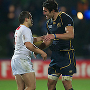 Kelly Brown, Scotland, (right) with Irakli Abuseridze, Georgia after the final whistle during the Scotland V Georgia Pool B match  during the IRB Rugby World Cup tournament.  Invercargill, New Zealand, 14th September 2011. Photo Tim Clayton...